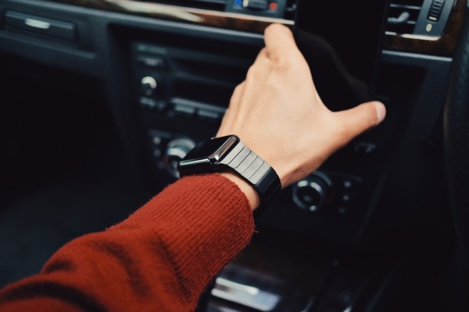 Anthony Beyer on a drive with, using his smartwatch for directions