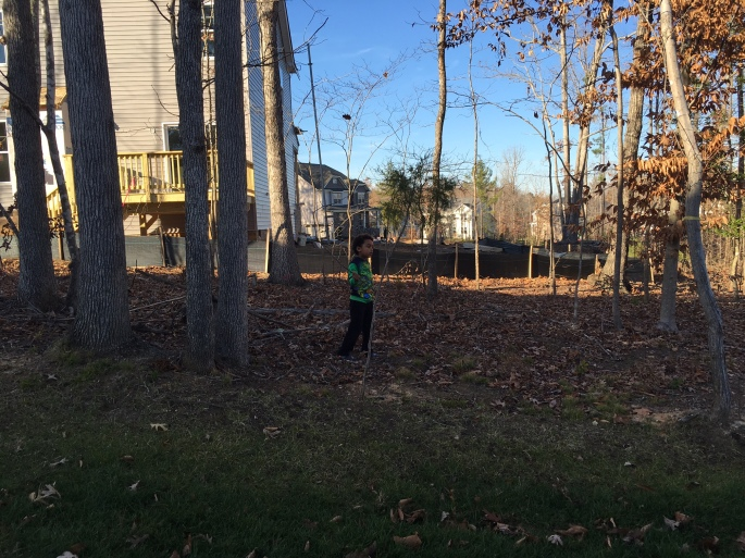 Anthony Beyer's son playing in the back yard, the leaves were falling already
