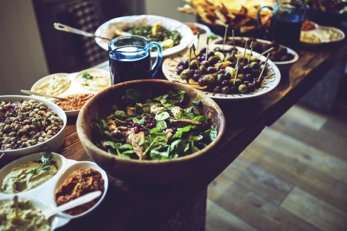 Anthony Beyer's photo of salads, hummus and other healthy foods for thanksgiving