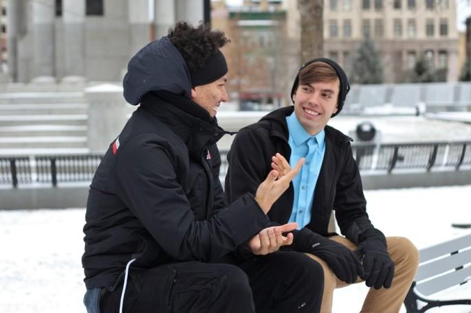 two gentlemen in conversation