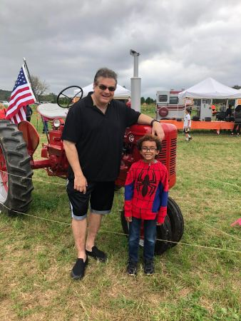 Father, son, and a big red tractor!